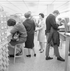 Library staff and card catalog