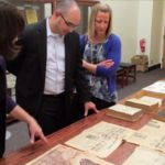 Stacy and Corey Lohman viewing special collection items at the PSU Library
