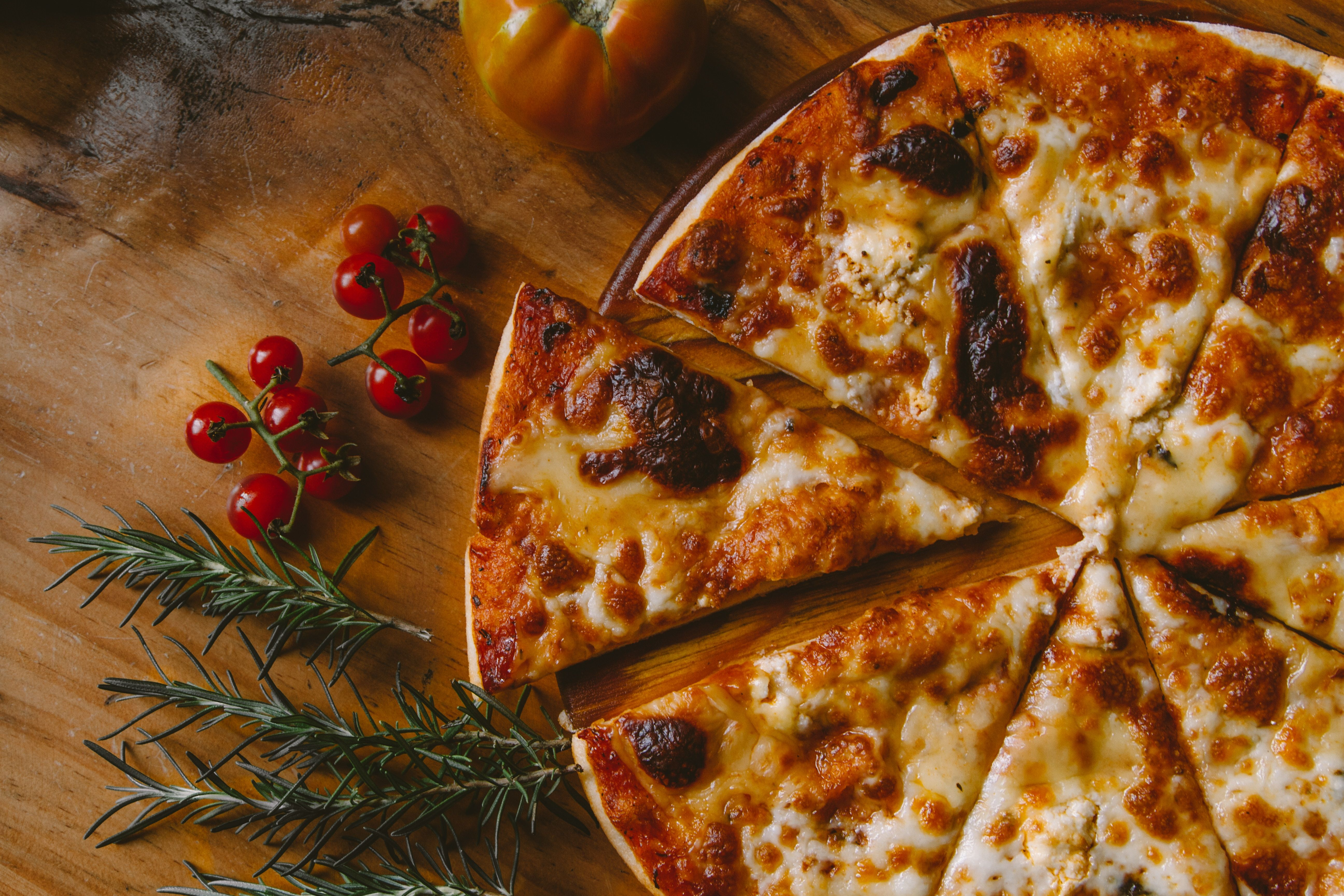 pizza surrounded by tomatoes
