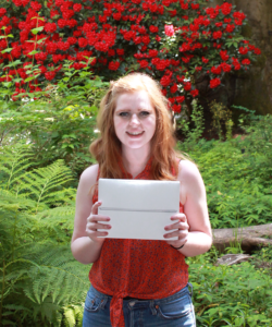 PSU undergraduate student with the grand prize iPad from the LibQUAL+ library survey