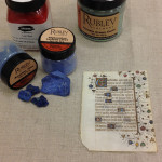 Pigments, azurite, lazurite, and small manuscript leaf.